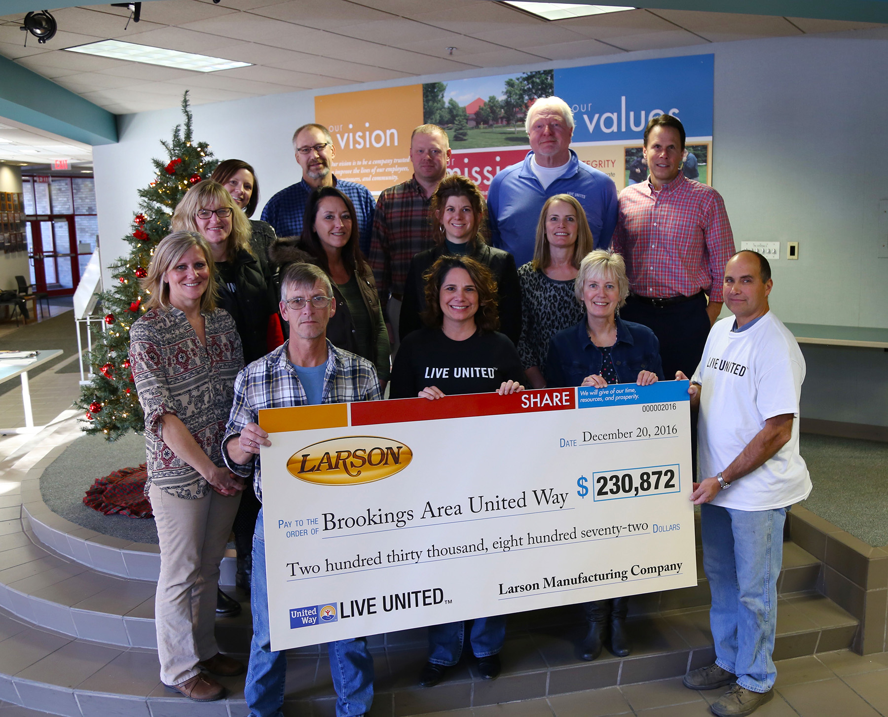 Larson committee presents United Way with check