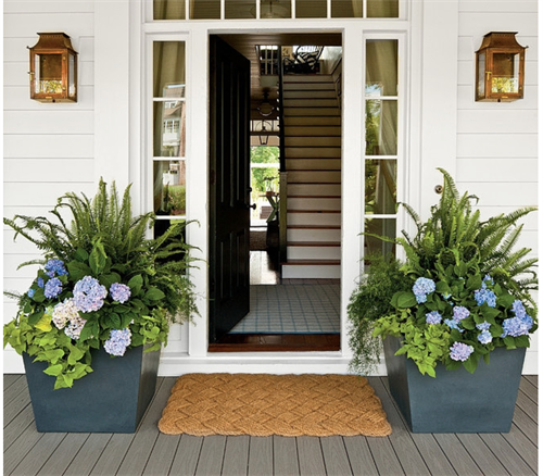 Create a symmetry around your door for a warm welcoming.