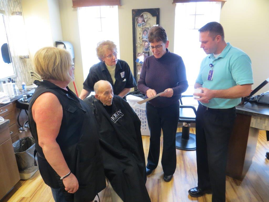 Larson Employees raise funds for assisted living center