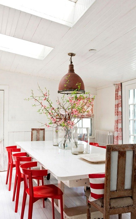 Add Red chairs to bring some unexpected cheer to your dining room table