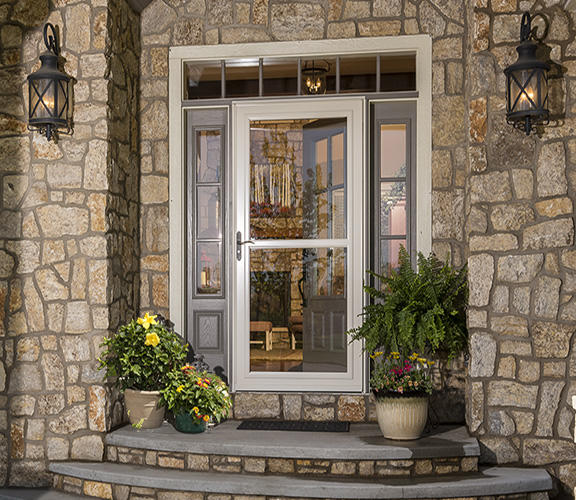 Tan Storm Door with Decorative Glass