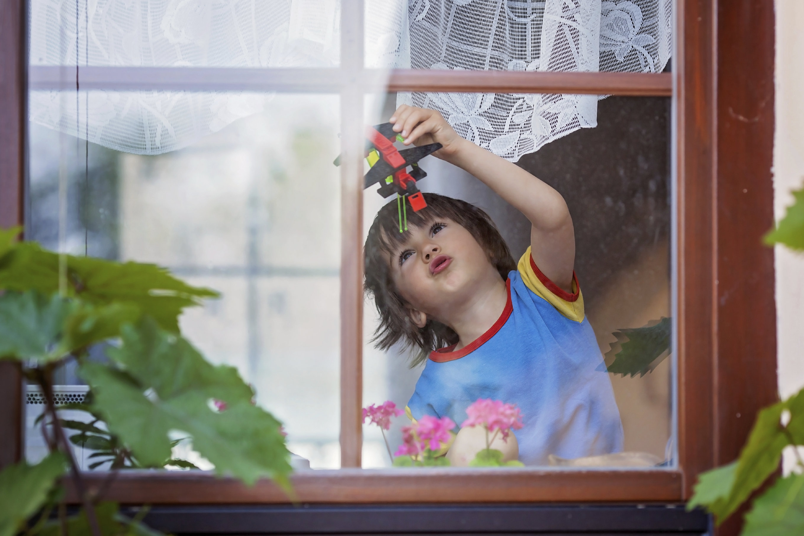 boy playing by window